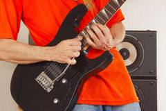 Hands of the rock musician playing the electric guitar Royalty Free Stock Image