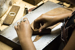 Hands rolling cigars in a factory Royalty Free Stock Photo