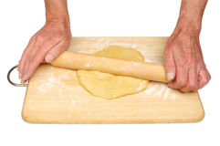 Hands rolling pastry Stock Images