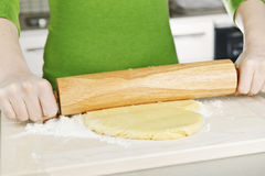Hands with rolling pin and cookie dough Stock Image