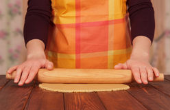 Hands with rolling pin Stock Images