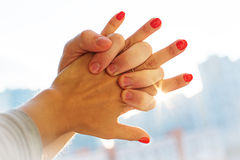 Hands of Romantic Couple Holding Together with Sun Rays Royalty Free Stock Photo