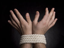 Hands with a rope Stock Images