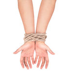Hands with a rope wrapped around them Stock Photography