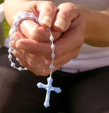 Hands with rosary Stock Images