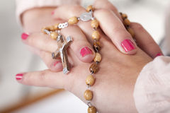 Hands with a rosary Stock Photos