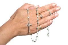 Hands and rosary beads. Hands praying, holding blue rosary beads isolated on white background stock image