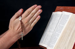 Hands with rosary and Bible Royalty Free Stock Image
