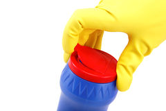 Hands in rubber gloves with a bottle of detergent Royalty Free Stock Image