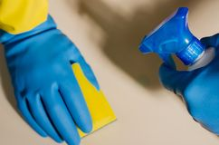 Hands in rubber gloves cleaning the surfaces of ceramic tiles, s. Afe and hygienic cleaning, keeping the house clean stock photography