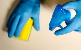 Hands in rubber gloves cleaning the surfaces of ceramic tiles, s. Afe and hygienic cleaning, keeping the house clean stock photos