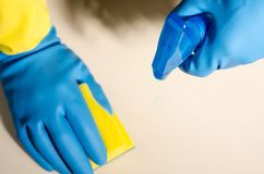Hands in rubber gloves cleaning the surfaces of ceramic tiles, s. Afe and hygienic cleaning, keeping the house clean stock image