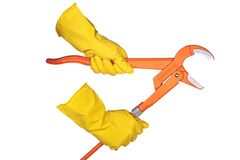 Hands in rubber gloves holding a pipe wrench. Hands holding a pipe wrench, isolated on white background Royalty Free Stock Photo
