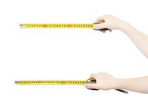Hands with rulers. Hands holding yellow rolled rulers, isolated, clipping path Stock Photos