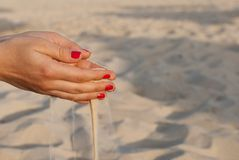 Hands with sand. Two hands with sand and red nails Royalty Free Stock Image
