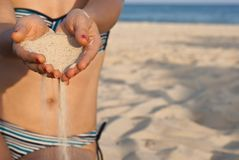 Hands with sand. Two hands with sand and red nails om the beach Royalty Free Stock Photography