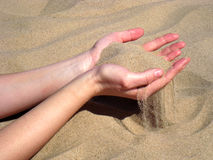 Hands with sand. My beautiful woman with me on the beach Stock Photography