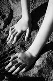 Hands in the Sand. Hands playing in the sand Stock Photography
