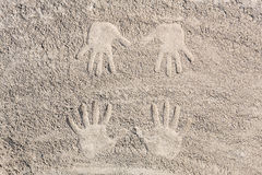 Hands in the sand Royalty Free Stock Photo