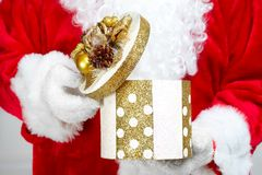 Hands of Santa Claus with gift Royalty Free Stock Image