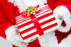 Hands of Santa Claus with gift Stock Photography