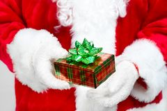Hands of Santa Claus with gift Stock Photos