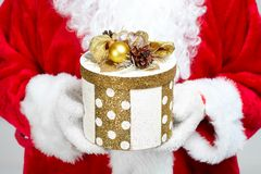Hands of Santa Claus with gift Royalty Free Stock Photography