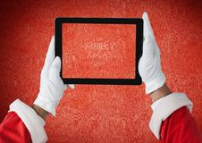 Hands of santa claus holding a digital tablet Stock Photo