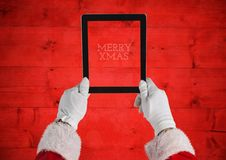 Hands of santa claus holding a digital tablet Royalty Free Stock Photos