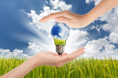 Hands saving Green Energy Stock Photo