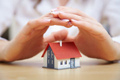 Hands saving house Stock Images