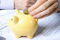 Hands saving money Stock Images