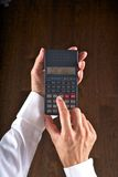 Hands with scientific calculator Royalty Free Stock Photo