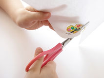 Hands with scissors. Cutting out of the paper picture Royalty Free Stock Images
