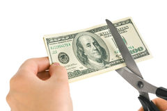 Hands with scissors cutting money Stock Photography