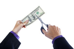 Hands with scissors cutting money Stock Photos