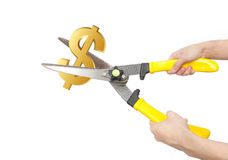 Hands with scissors cutting us dollar. Isolated on white background Stock Image