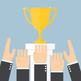 Hands scramble for the trophy Stock Photography