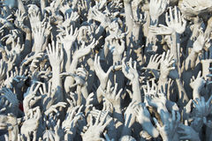 Hands sculpture in Wat Rong Khun. Royalty Free Stock Photos