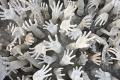Hands sculpture at Wat Rong Khun temple, Thailand Stock Photos