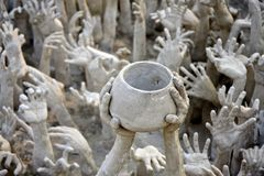 Hands sculpture at Wat Rong Khun temple, Thailand Royalty Free Stock Photos