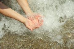 Hands in sea water Stock Photo