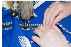 Hands of the seamstress. Behind work on the sewing machine Royalty Free Stock Photos