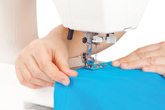 Hands of a seamstress at the sewing machine Royalty Free Stock Photos