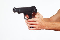 Hands with semi-automatic gun on white background Royalty Free Stock Photography