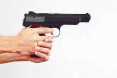 Hands with semi-automatic handgun on white background Royalty Free Stock Images