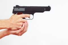 Hands with semi-automatic pistol on white background Stock Photos