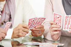 Hands of senior adults playing Royalty Free Stock Photos