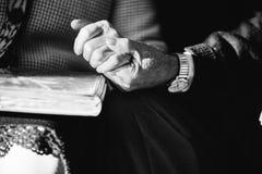 Hands of senior couple