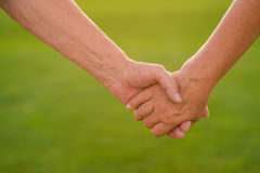 Hands of a senior couple. Royalty Free Stock Images